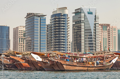 Dubai Creek with colorful dhows
