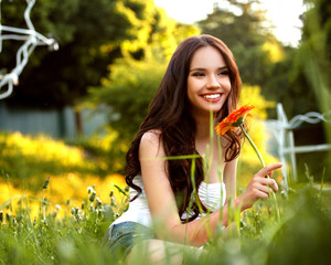 Beautiful Girl With Red Flower. Beautiful Model Woman Face.