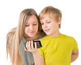 Boy and girl looking at phone