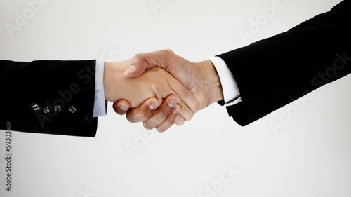 Handshake between a businessman and a businesswoman