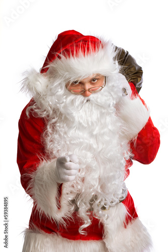 Santa Claus pointing to the camera isolated on white