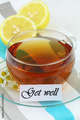 Get well card with cup of chamomile tea and lemon