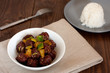 sweet and sour meatballs with pineapple chunks and white rice