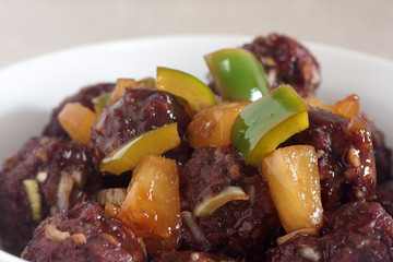 sweet and sour meatballs with pineapple chunks