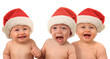 Funny Christmas babies, crying boy in the middle.