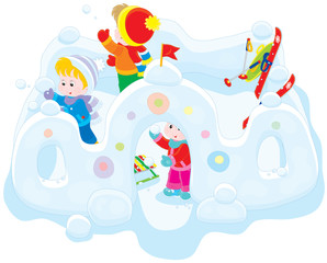 Children playing snowballs in a snow fortress
