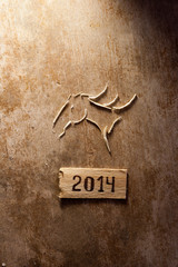 tags with 2014 on a wooden surface and horse