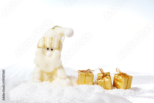 Santa Claus with gifts in the snow