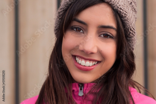 Closeup of young woman with beanie