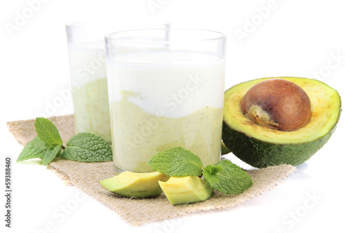 Fresh avocado smoothie isolated on white