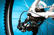 Rear bike cassette on the wheel with chain on the blue