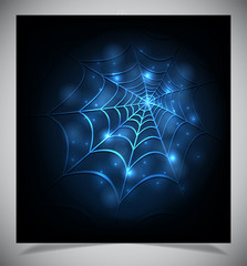 Glowing spider web on a dark background