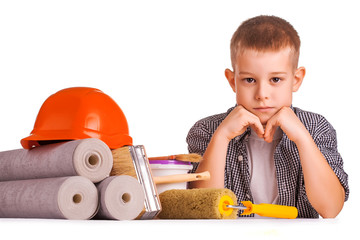 cute boy with a roll of wallpaper and brush. isolated