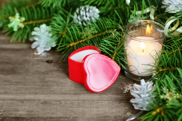 Christmas background with a gift in the form of heart