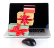 Laptop, gifts and computer mouse isolated on white