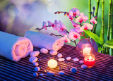 Fototapety heart of stones massage with candles, orchids, towels and bamboo