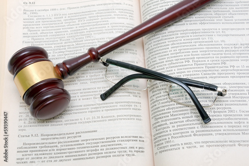 gavel, glasses and book Russian laws