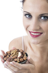 Model Released. Attractive Young Woman Eating Mixed Nuts