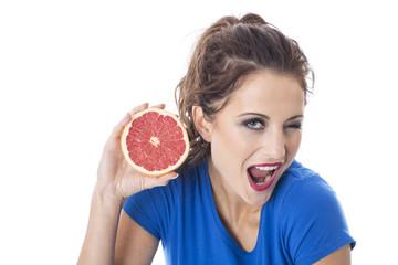 Woman Holding Pink Grapefruit