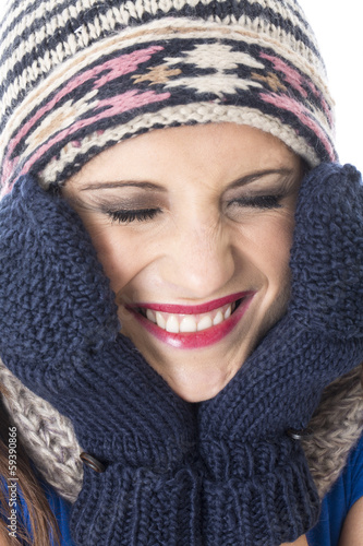 Young Woman Wearing Woolly Hat and Gloves