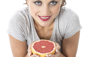 Young Woman Holding Pink Grapefruit