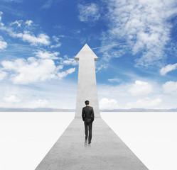 businessman walking on arrow