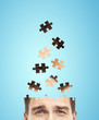 head businessman built of puzzle
