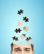head businessman built of puzzle