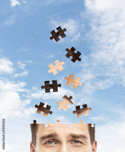 head man built of puzzle