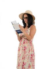 Woman reading travel guide of Brazilo