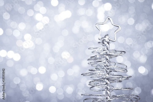 detail of metallic modern christmas tree on wood table