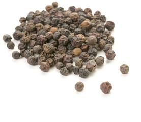 Whole peppercorn scattering on white background.