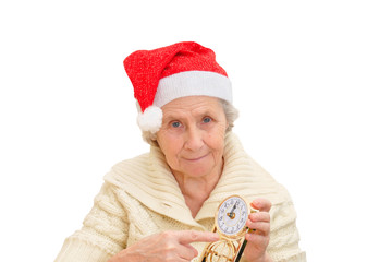 granny in red Santa Claus hat and clock