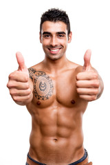 Fit man showing thumbs up