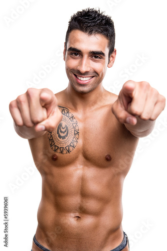 Fit man pointing front