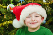 Christmas portrait of happy child wearing Santa hat
