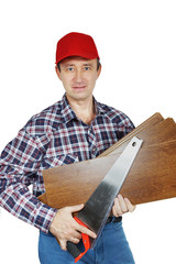 Carpenter with handsaw and woods