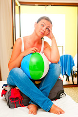 beautiful girl with a ball and a suitcase