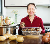mature woman with dried mushrooms