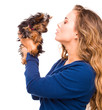 young woman holding Yorkshire terrier dog