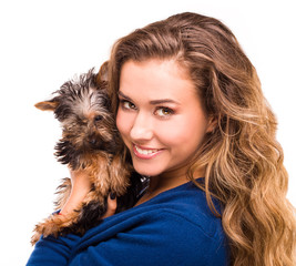 girl holding cute yorkie, isolated on white