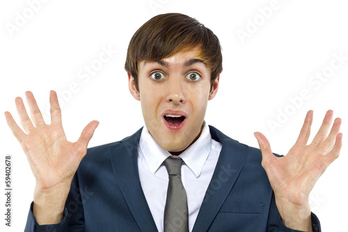 young businessman with mocking gesture on white background
