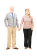 Full length portrait of a middle aged couple holding hands