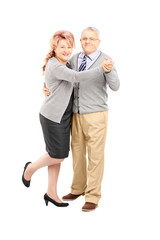 Full length portrait of a middle aged couple dancing