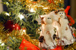 Snowman ornaments and bows in Christmas tree
