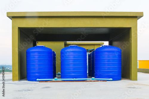 Leinwanddruck Bild blue plastic water tank