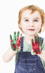 cute little girl with finger paint looking up