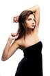 Serious and elegant brunette in black dress