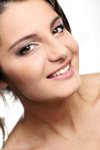 Attractive and happy girl with brown eyes