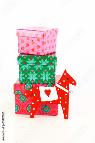 Horse toy with gift boxes isolated on white